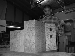 Peter Loh putting the finishing touches on a cabinet